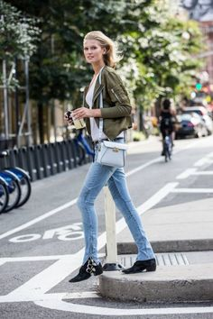 Green bomber + white T-shirt + blue skinny zip jeans + buckled boots