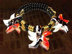Collar de ágatas negras con tres estrellas de mar de cristal de Murano.