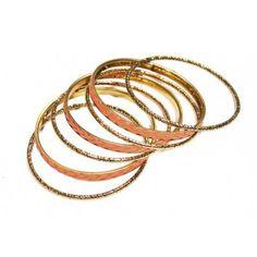 Ibero Peru Collection bracelets in golden and orange shades. Ibero Peru malliston rannerengassetti, jossa patinoitunutta kultaa ja oranssia. http://www.ibero.fi/rannekorut/kaulakorut/7-kpl-rannerenkaita/