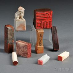 Group of Nine Seals, China and Japan, a square bamboo seal, two ivory seals, four rectangular hardstone seals, and two wood seals, all with carved seal faces, lg. to 1 3/4 in.