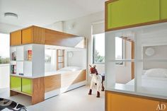 The bunk room in a Hamptons, New York, guesthouse by architects Leroy Street Studio and designer Thad Hayes provides plenty of space for visiting family and friends. The color-blocked Nurseryworks bunk beds pack a geometric punch in the otherwise serene space. (August 2011)