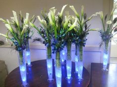 wedding center pecis tables | Centerpieces with gel and lights made of Calla lilies and peacock ...