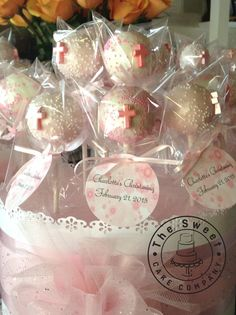 Christening or communion Cake Pops table centerpieces. Pink and white. Pink Crosses.