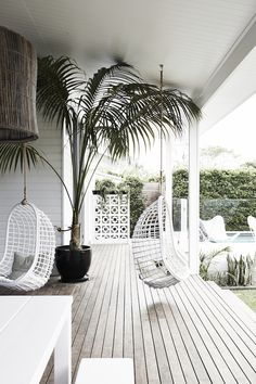 Hanging rattan chairs on the terrace at Magnolia house holiday home.
