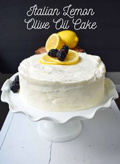 This Italian Lemon Olive Oil Cake is the perfect tender moist lemon cake. It is topped with a sweet lemon vanilla frosting that will knock your socks off.