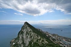 """Another shot of the Strait of Gibraltar, only this one showcases one of the """"Pillars of Hercules"""" with Gibraltar in the foreground and North Africa in the background.  According to Plato, Atlantis was beyond the Pillars."""