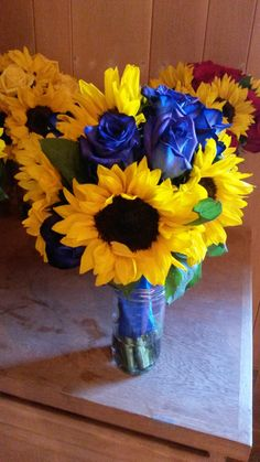 bridesmaid bouquet, sunflowers and blue roses.