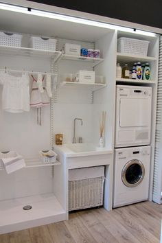 Deulonder - laundry/mud rooms - concealable laundry room, bi-fold doors, louvered doors, louvered bi-fold doors, hardwood floors, light hard...