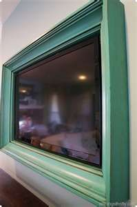 Custom TV Frames built and designed at Gold Leaf Gallery.  Match your decor with a TV frame...great idea!