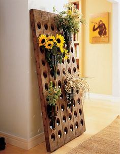 How To: Make a Riddling Rack. But what if you don't have a need for such wine storage? You could use it to hold vases--made out of wine bottles, of course. Wall Hanging Wine Rack, Riddling Rack, Just Wine, Pot Rack, In Vino Veritas, Tasting Room, Home Decor Inspiration, Diy Design, Design Ideas