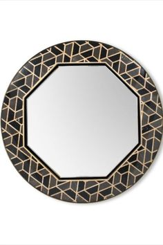 This unique mirror is inspired in the Tortoises hard outer shell. It is made of high gloss black lacquered wood that contrasts with hexagonal Anthracite, Nero Marquina and Yellow Triano marble details. This glamorous pattern makes this piece easy to combine in different luxurious environments  #bathroomdesign #contemporarybathrooms #modernbathrooms #classicbathrooms #mid-centurybathrooms #eclecticbathrooms #luxurybathrooms