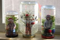 Kids in snow globes on window