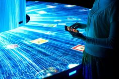 Audience members can touch the images and transfer the image to their smartphone | DIVERSITY | Teamlab expo exhibitsjapan pavilion