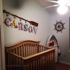 """Check out 58"""" Stained or Painted 6-Peg Paddle Name Rack with Six 9"""" Decorative Letters and Rope / Nautical Nursery Decor / Beach / Lake / Canoe Paddle on seaweeddesigns"""