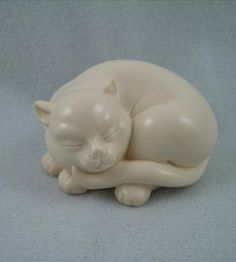 "This sculpture is part of the Franklin Mint Curio Cabinet Cats Collection. Each of the cats in the collection represents a different style of art. This particular 2.5"" long model represents the Netsuke style of 17th century Japan. A Netsuke was a decorative carved fastener for pouches and other containers hanging from the belt of a traditional Japanese garment."