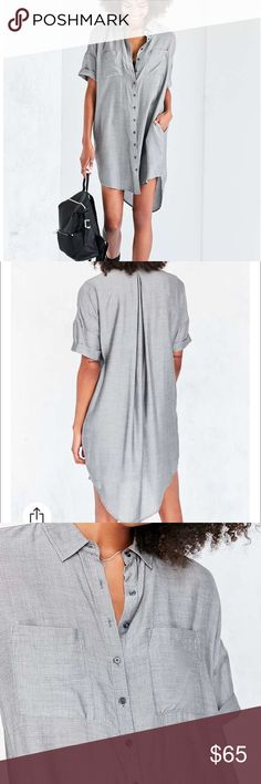 """BDG CARTER COCOON SHIRTDR Medium / grey black/ Slouchy button-down shirt dress from BDG in a modern cocoon silhouette. In an oversized fit with a drapey high/low hem + cuffed short-sleeves. Finished with a pleat-back detail, pouch pockets at the chest + hidden pockets at the sides.  Content + Care - Rayon - Machine wash - Imported  Size + Fit - Model is 5'10"""" and wearing size Small  - Measurements taken from size Medium             - Chest: 46""""         - Length: 36.25"""" Urban Outfitters…"""