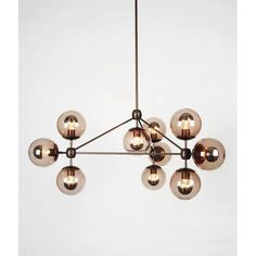 Modo chandelier is made of machined aluminium and glass. The chandelier has three sides and incorporates ten globe lights. The Modo chandelier is inspired by of 5 Light Chandelier, Sputnik Chandelier, Pendant Lighting, Chandeliers, Lustre Globe, Ceiling Fixtures, Ceiling Lights, Light Fixtures, Ceiling Fans