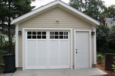 This garage was made affordable by using James Hardie siding, aluminum overhangs and a stunning steel overhead door. This garage was made affordable by using James Hardie siding, aluminum overhangs and a stunning steel overhead door. Small Garage, Garage Shed, Garage Plans, Detached Garage, Shed Plans, Car Garage, Garage Ideas, Garage Workbench, Door Ideas