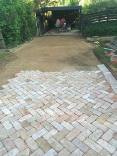 Bedding sand and paving in progress.