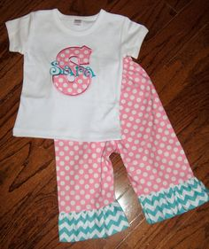 custom boutique childrens clothing christmas applique monogrammed t-shirt skirt pants birthday outfit. $32.00, via Etsy.