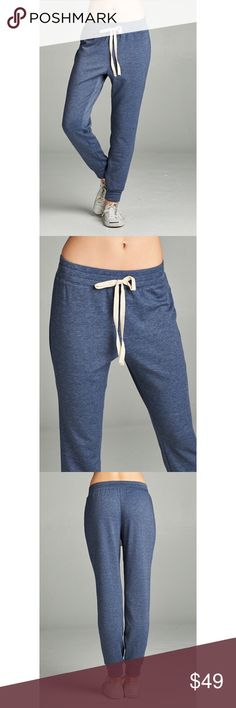 🆕 Navy Joggers Semi-loose fit. Full length. Elastic at waist with twill tape tie detail. Very soft, stretches well and is not sheer. Inside has a very soft fuzzy texture that is plush and warm. 62% polyester 36% polyester 2% spandex. No trades. No lowball offers. Also available in charcoal. Pants Track Pants & Joggers