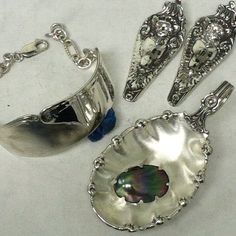 made from spoons - a pendant with a blister pearl, 2 angel pendants and a bracelet :)