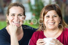 Two middle-aged women posing smiling royalty-free stock photo