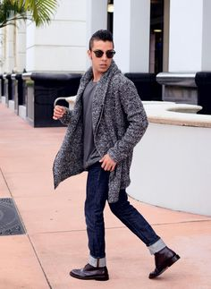 Pair a charcoal shawl cardigan with navy jeans for an easy to wear, everyday look. Go for a pair of burgundy leather brogue boots to show your sartorial savvy.  Shop this look for $107:  http://lookastic.com/men/looks/shawl-cardigan-jeans-sunglasses-crew-neck-t-shirt-brogue-boots/4655  — Charcoal Shawl Cardigan  — Navy Jeans  — Black Sunglasses  — Charcoal Crew-neck T-shirt  — Burgundy Leather Brogue Boots