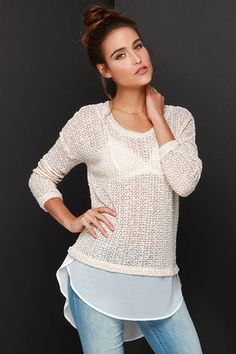 "With how darling you will look in the Snuggle Up Beige High-Low Sweater Top, don't be surprised if your beau tries to steal a smooch or two! From a rounded neckline, nubby beige and cream knit forms a cute oversized top with long sleeves, and a panel of ivory chiffon shaping a chic high-low hem. Unlined and sheer. Top measures 4.5"" longer at back. Self: 67.4% Polyester, 32.6% Rayon. Contrast: 100% Polyester. Dry Clean Only. Made With Love in the U.S.A."