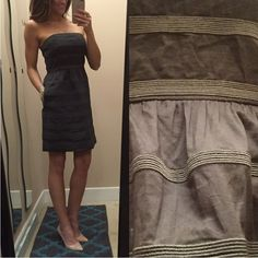 """J. Crew strapless dress with pockets I love this dress so much. It's dark grey with textured stripes. It has side pockets and an adjustable elastic strap inside so that it stays up without having to constantly pull it up.  size 2, perfect condition. 100% cotton. I'm 5'5 for reference *laying flat •across the top 14"""" •empire waist (most narrow) 13"""" •bottom opening 20"""" •length 27.5"""" J. Crew Dresses Mini"""