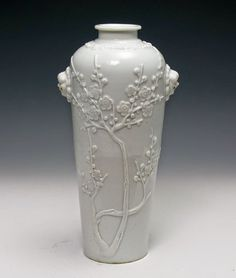 A Chinese Qianlong Blanc-de-chine Vase with relief worked apple blossoms.