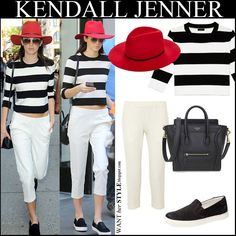 Kendall Jenner in black and white striped cropped sweater, red felt hat, white cropped pants, black slip on shoes and black tote