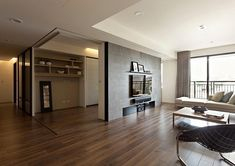 Retractable interior wall for modern apartment Modern apartment with retractable glass walls for home office area