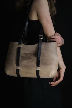 Our handmade leather Wide Forest Tote bag is a rugged, elegant, large leather tote bag/purse featuring water buffalo leather, our unique hand sewing, and adjustable handles that cradle the load. It is perfect for a trip to the farmers market! A wide version of our forest tote.  Dimensions at its widest points: 15 inches wide 10 inches tall 3 inches deep straps 0.75 wide  Please select from the following color choices: Taupe Water Buffalo Black Water Buffalo Brown Water Buffalo  Pictured ...