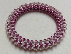 Join me on Facebook https://www.facebook.com/GinasGemcreations?ref=hl&ref_type=bookmark Learn to make cubic right angel weave Bangle. Materials: Approximatel...