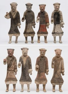 A group of eight Chinese pottery warrior figures: each standing with right hand raised and wearing painted tunic, Han Dynasty, approx 44 cm high.