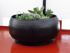 turning old tires inside-out for plain planters for outside.