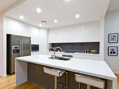 A kalka kitchen. 2Pac cabinetry, colourback glass splashback, Northern Beech timber flooring. Small lot home, Alderley, Brisbane