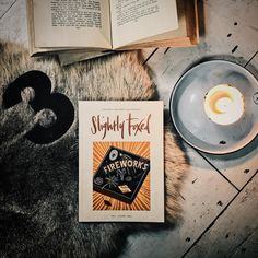 Essential requirements for todays #getfoxed60 photo shoot: Issue 3 of #slightlyfoxed; a rusty old number 3; a book; a hint of scuffed floorboards; another book; a dash of cosy fur ... Wait! We need a candle for added atmosphere. That shall do. Now a caption: How about Sharks Otters and Fast Cars? That will fox them. But perhaps thats too foxing. Hmm. We could go with When we were three we were hardly ... Drat that one doesnt work either.  But let us gloss over all of this for its Friday good…
