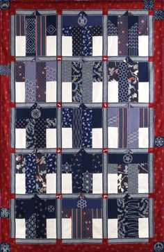 Quilt. A traditional quilt pattern in Japan. 15 blocks of Kimono were pieced. Used Sashiko to create designs in Kimono and Kamon (family crests). - (Studio Aika)