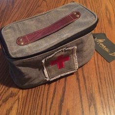 DOPP kit for your man! Toiletry bag. Toiletry bag for overnight or weekend trips. Leather handle. Top zips open on 3 sides. Synthetic grey lining for easy cleaning. Khaki canvas color. Full-size products can easily fit in this bag. 4 inches deep, 6 inches wide, and 10 inches in length. Nice and durable! Mona B. Bags Travel Bags