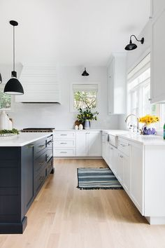 Modern Farmhouse Kitchen Painted in Sherwin Williams SW 7006 Extra White; one of the Whitest Paint Colors You Can Find