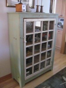 Upcycle your old windows into custom cabinets like these.