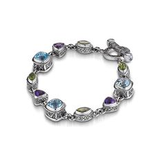 Bangles and Bracelets are huge this year, and with gorgeous bangles like this Sterling Silver, Blue Topaz, Amethyst, and Peridot bracelet by Sara Blaine we can see why!