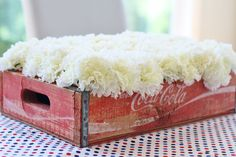 Love this floral arrangement for any vintage-themed party - flowers in a vintage soda crate - #partydecor
