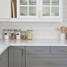 Putting the final touches on our kitchen - IKEA two toned cabinetry, quartz countertop, gold hardware, and classi white subway tile.