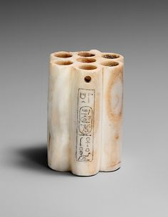 Egypt, 1492–1477 B.C.E.  Kohl Jar in the form of a bundle of reeds. A flat lid (now missing) once swiveled around a metal pin, a piece of which still remains in the hole.