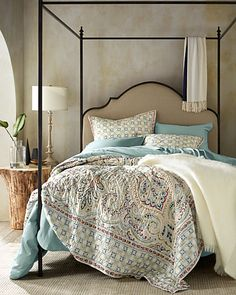 An elegant approach to the printed whole-cloth quilt, this oversized paisley design with a tile-inspired border has the look and feel of a grand piazza.