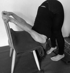 Uttanasana variation to relieve neck tension. More stable if chair is placed against wall.