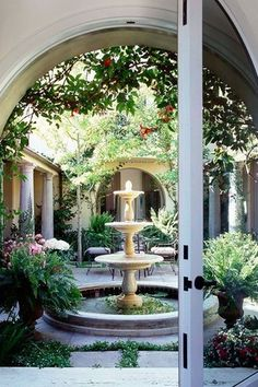 Traditional Patio with Fountain, Raised beds, exterior tile floors, French doors